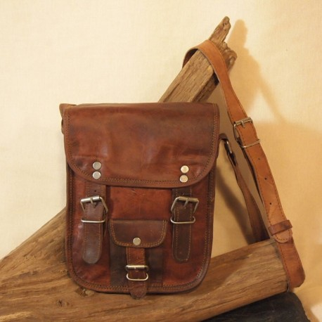 Small leather notebook bag, rounded corners.